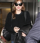 Dakota Johnson Arrives at LAX Airport - December 21