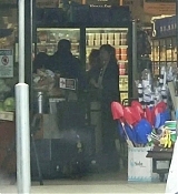 Dakota_Johnson___Chris_Martin_-_Try_to_hide_as_they_pick_up_groceries_together_in_Malibu2C_CA_-_May_2000009.jpg